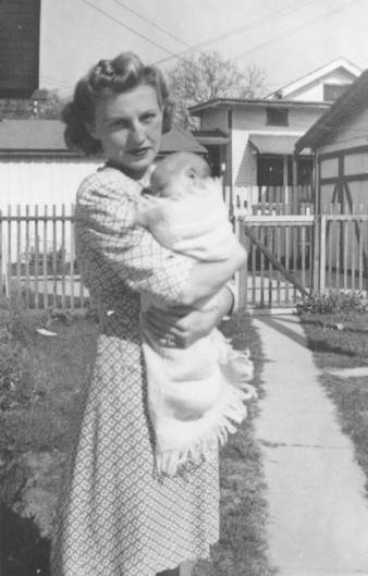 My mother, Lydia, holding my sister Martha